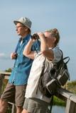 Senior Couple Hiking and Birdwatching with Binoculars poster