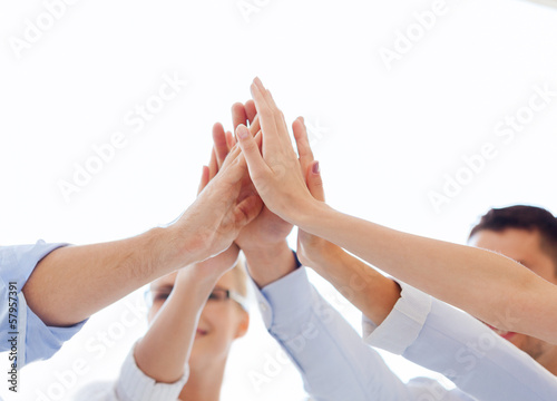 canvas print picture happy business team giving high five in office