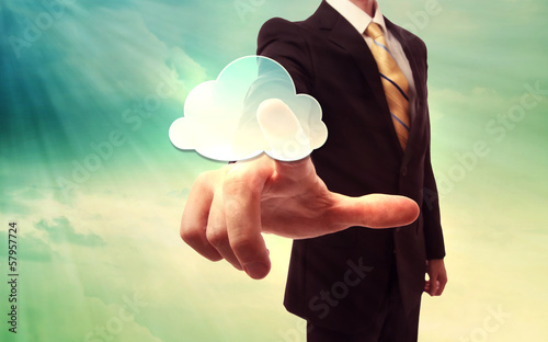 Businessman pressing a cloud computing icon