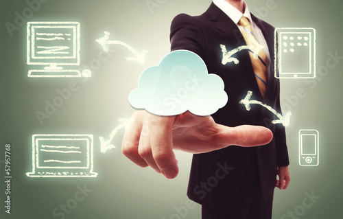 Businessman pressing cloud icon