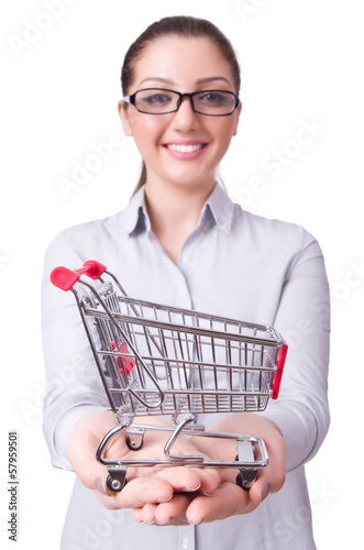 Young woman with shopping cart on white