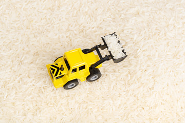 Industrial tractor toy on the rice grains