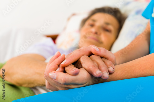 Caring Nurse Holding Hands - 57959727