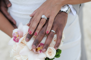 black couple hands and flowers