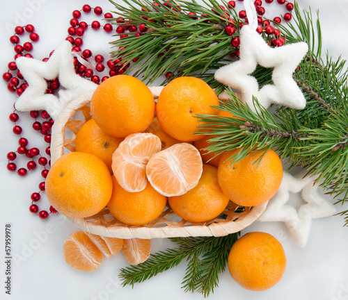 new year decoration with mandarins and fir tree