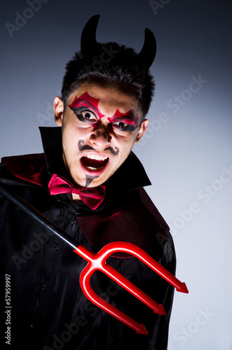 canvas print picture Man in devil costume in halloween concept