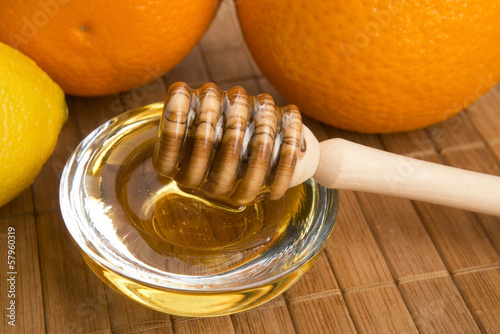 fresh honey with lemon and orange fruits