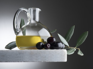 still life with bottle of olive oil and olives