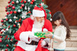 Girl Taking Gift From Santa Claus