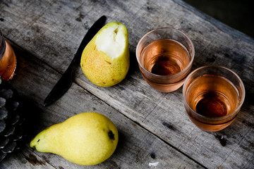 couple glasses of rose vine and two pears