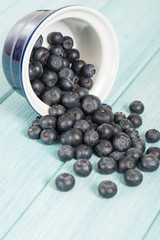 Blueberries - Delicious juicy blueberries on a blue wooden table
