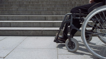 wheelchair approaching stairs low angle view