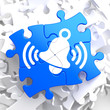 Ringing White Bell Icon on Blue Puzzle.