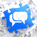 White Speech Bubble Icon on Blue Puzzle.