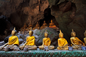 Row of buddha statues in the cave, Petchburi province, Thailand