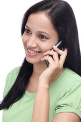 Young Indian girl talking on cell phone