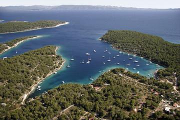 Sailing boats in quiet bay on island Brac in Croatia