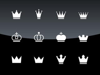 Crown icons on black background.