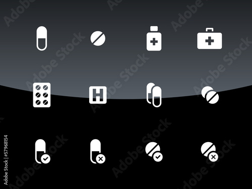 Pills, medication icons on black background.