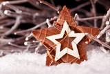 christmas star decoration with wooden branches