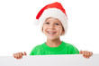 Christmas boy standing with empty banner