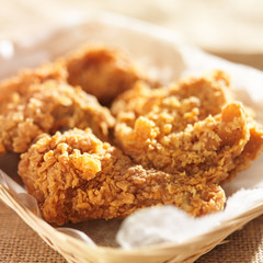 fried chicken pieces in a basket