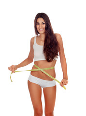 Girl in black underwear with a tape measure around her waist