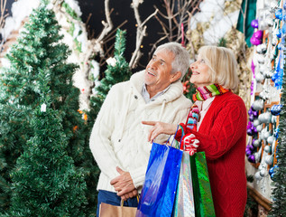 Couple Shopping At Christmas Store