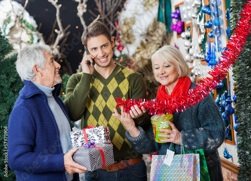 Family Shopping In Christmas Store