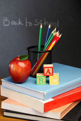 ABC cubes color pencils and red apple