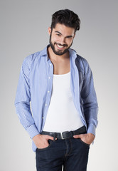 attractive sexy man with beard dressed casual smiling