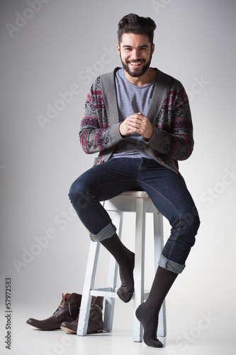 attractive sexy man dressed casual smiling in the studio
