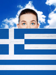 woman face behind wall with greece flag