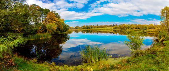 Forest lake in fall. Panorama