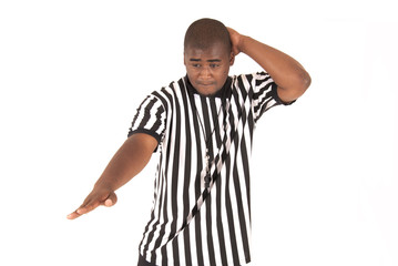 black referee calling an offensive foul