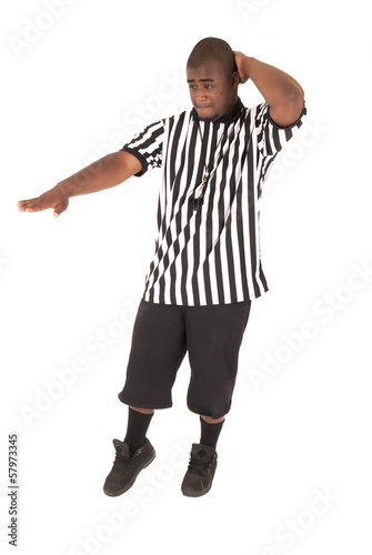 black referee calling a charging foul
