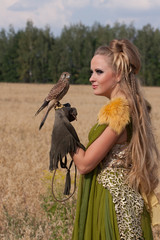 Old style Woman with hawk on hand