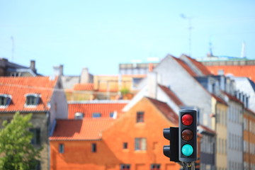 Traffic lights against city background