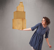 Young lady holding a set of brown cardboard boxes