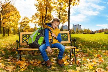 Boy with backpack in the park