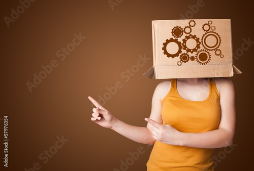 Young woman gesturing with a cardboard box on his head with spur