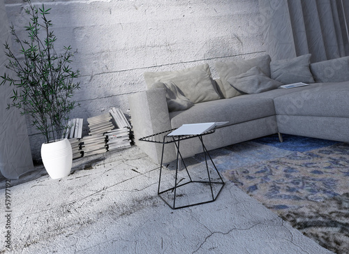 Gray couch against concrete wall with carpet