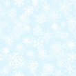 Christmas seamless pattern of snowflakes on light blue