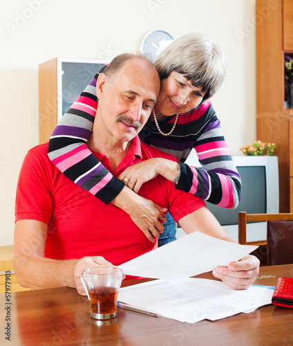 mature family  with financial documents