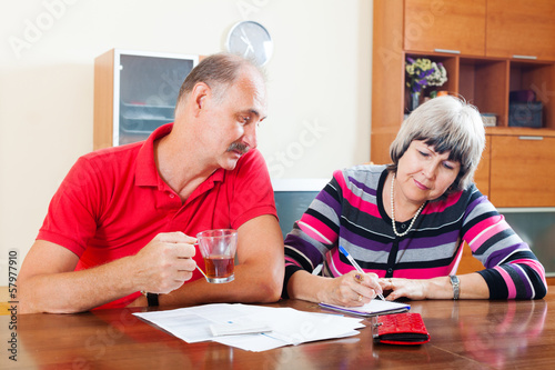 mature couple fills in questionnaire together