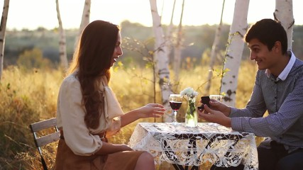 Young Man Proposing to Girl Romantic Nature Date Concept