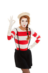 Portrait of a  mime comedian showing OK, isolated on white backg