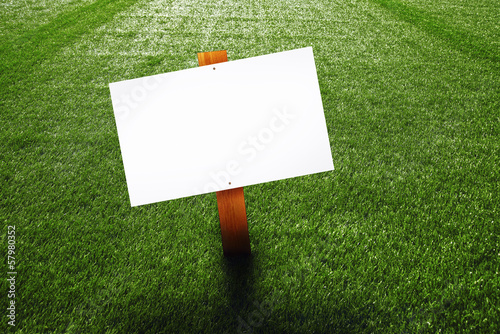 Blank wooden sign on the lawn