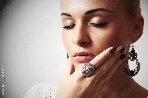 Beautiful woman.Jewelry and Beauty.liquid sand manicure