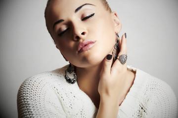 Beautiful woman in white dress.Jewelry and Beauty.winter style